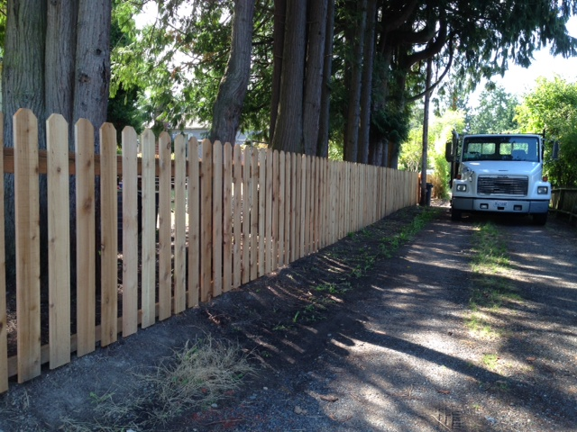 "This is a great example of our No. 2 Select ""No Hole"" Fencing, which is the standard fence board we supply unless otherwise specified. This particular fence is made from 3/4″ net thick material that the customer made a custom, decorative top cut to."
