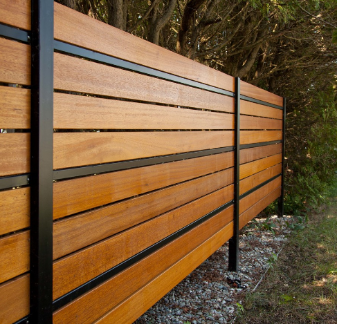 Golden Balau Hardwood Decking used as vertical fencing