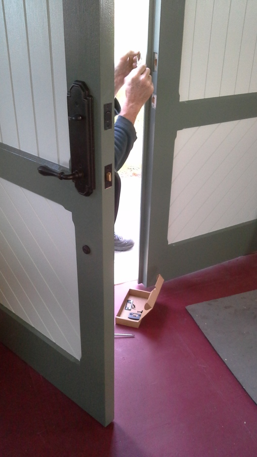 Installing the replicated doors at the Turn Point Light Station