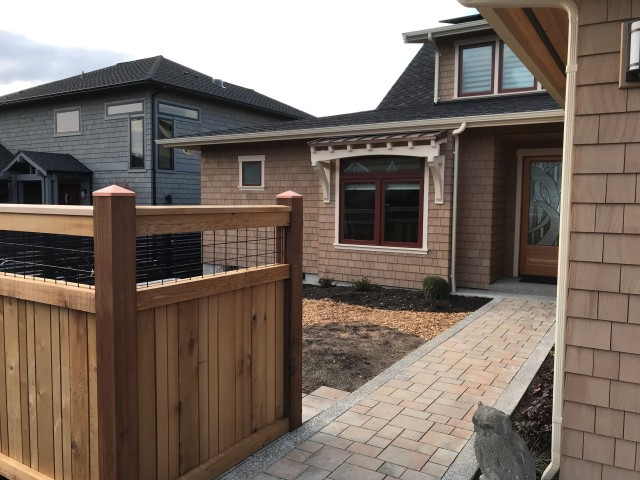 Western Red Cedar shingles used as exterior cladding and custom cedar fencing