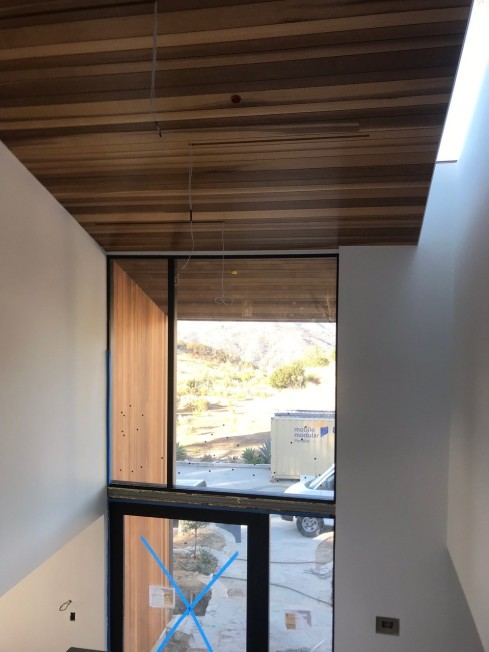 clear western red cedar installed on interior ceiling and carried through to the home's exterior