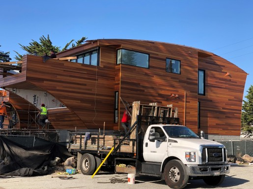 custom cut western red cedar siding being installed on a home in california