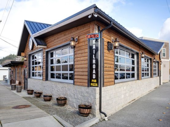 knotty Western Red Cedar bevel siding is one of the most budget friendly natural wood siding options available