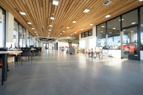Knotty Western Red Cedar installed on the ceiling of this car dealership adds warmth to an otherwise cool space